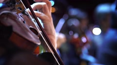 Concert, a musician hand playing the violin, close up shot Stock Footage