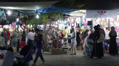 TURKEY 18th JULY 2016, Locals and tourists browsing stalls at a night market Stock Footage