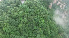AERIAL TILT SHOT OF TRADITIONAL CHINESE TIANZI TEMPLE IN MISTY AVATAR MOUNTAINS Stock Footage