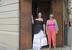Two women are near entrance to Dali-Jewels in Fifueres, Spain. - stock photo
