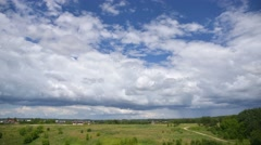 Landscape, coming rain stormy cumulus clouds rolling over countryside time-lapse Stock Footage