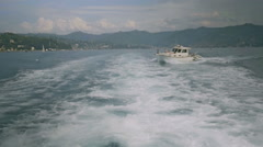 Yacht Passing through Wake - 29,97FPS NTSC Stock Footage