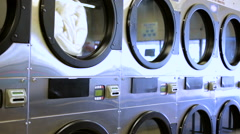 Industrial washing machines in a public laundromat. Stock Footage