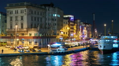 View of docks at night from the Galata Bridge - stock footage