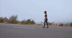 Fitness woman starting her run on countryside road - stock footage