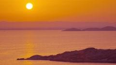 Beautiful sunset on sea shore landscape seascape establishing shot. Stock Footage