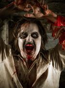 Flesh eating zombie Stock Photos
