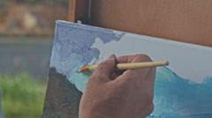 Closeup Painter Hand Paints Landscape Picture in Oils Stock Footage