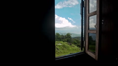 Camera Moves to Open Window Shows Hilly Landscape Stock Footage