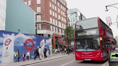 Police car races passed iconic London bus on Oxford Street Stock Footage