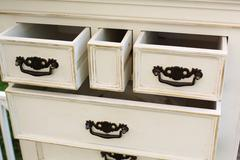 Vintage wooden chest of drawers with black metal handles open - stock photo