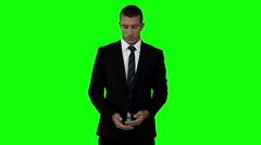 Businessman with globe animation in front of green screen Stock Footage