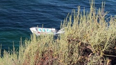 Shipping water in a small boat off the Portuguese Algarve coast Stock Footage