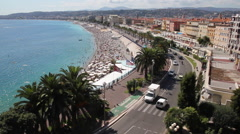 Cars and trucks on boulevard Nice, France Stock Footage
