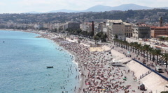 Sea, beach and boulevard in Nice, France Stock Footage