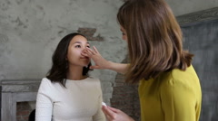 Beautiful model gets a professional makeup done by a visagist. Super video Stock Footage