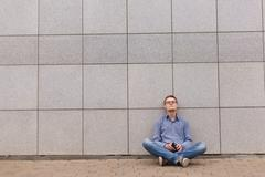 Hopeless businessman sitting on a ground Stock Photos