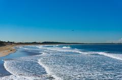 Beautiful ocean beach with blue sky Stock Photos
