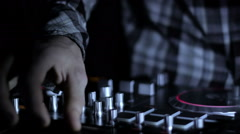 Hands of DJ which mixes music tracks CD mixer in nightclub Stock Footage