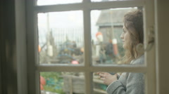 4K Young romantic couple at beach house, talking & looking out at the view Stock Footage