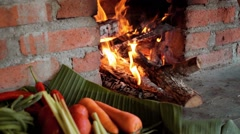 Ingredients on palm leaf basket near a traditional brick fireplace Stock Footage