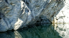 Marble rock in the azure waters. Stock Footage