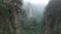 CINEMATIC AERIAL TILT FLY BY OF ZHANGJIAJIE AVATAR MOUNTAINS IN HUNAN CHINA Stock Footage