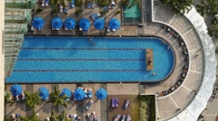 Beautiful Blue Resort Swimming Pool with Swimmers - stock footage