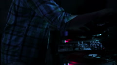 DJ scratching vinyl records and mixing on the Decks at a disco in Nightclub loop Stock Footage