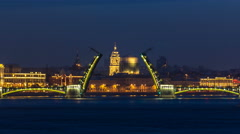 Night view of spit of opened Birzhevoy Bridge timelapse, Saint Petersburg Stock Footage