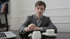Worker lays down sugar into the cup and stir. Stock Footage