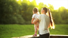 Happy mother with child enjoying together in sunny nature, Mom and daughter - stock footage