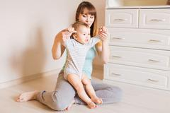 Mother and baby legs. First steps Stock Photos