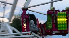 The girl and the guy on the Dangerous attraction in the park - stock footage