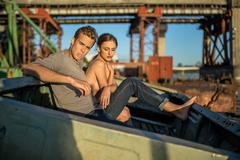 Sexy couple in old boat Stock Photos