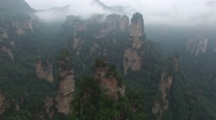 AERIAL SEQUENCE POINT OF INTEREST SHOT OF AMAZING ROCK CLIFF MOUNTAINS CHINA Stock Footage