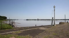 Lydney harbour jetty view across the River Severn estuary towards Berkely pan Stock Footage