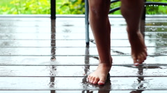 Barefeet girl dancing under the rain enjoying warm summer weather Stock Footage