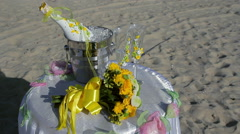 Champagne bottle in ice bucket, two glasses and wedding decor on the beach Stock Footage