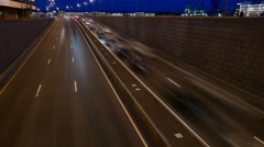 Night heavy traffic at underpass exit, cars stop and quickly rush, time lapse Stock Footage