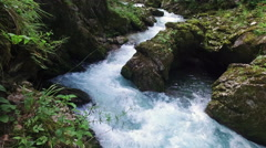 4K. Wild river flows in Alps Mountains, clean blue water. Stock Footage