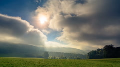 Sunbeams falling through moving clouds - stock footage