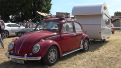 French vintage car and trailer - Citroën 2cv in collector's car meeting - pan Stock Footage