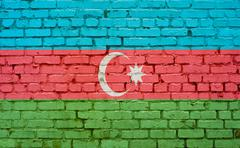 Flag of Azerbaijan painted on brick wall, background texture Stock Photos