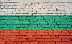 Flag of Bulgaria painted on brick wall, background texture Stock Photos