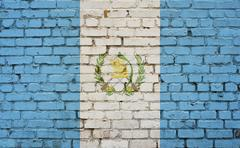 Flag of Guatemala painted on brick wall, background texture - stock photo