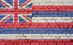 Hawaii US flag painted on old vintage brick wall Stock Photos