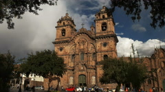 Church of the society of jesus in cusco framed by trees Stock Footage