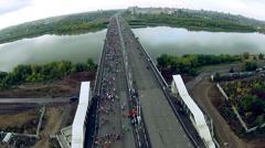 People run a marathon on the road bridge Stock Footage