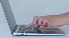Hand girl female press  buttom keyboard laptop keyboard white Stock Footage